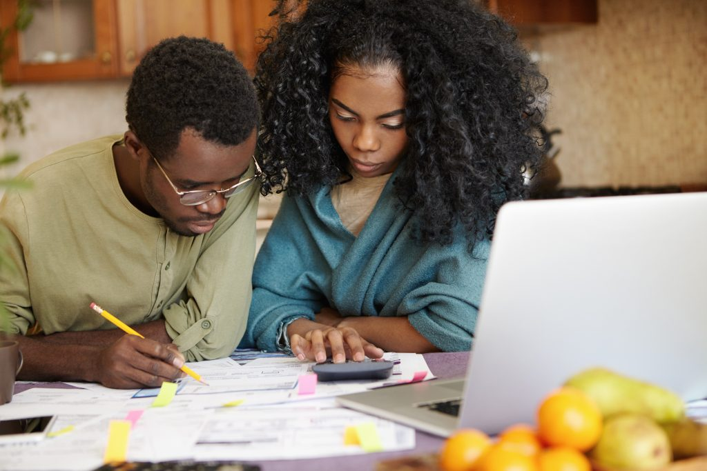 Couple interesting in the FIRE movement calculating how much money they need to save and invest in order to retire early and become financially independant